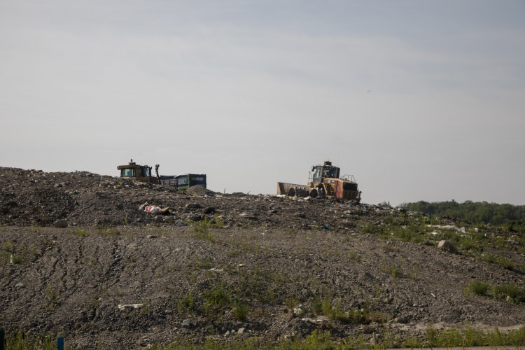 Landfill with equipment working