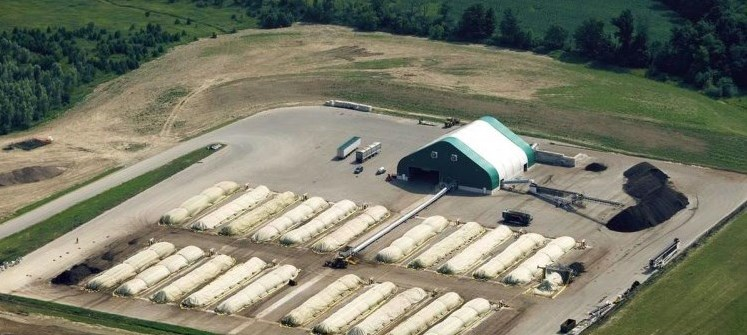 Aerial view of a centralized composting site with rows of covered organic material
