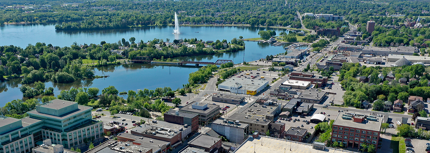 aerial view of the City with the Otonabee River on a sunny day