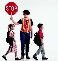Image of crossing guard with children