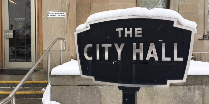 City Hall sign with snow on it