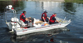 Water rescue boat in the water with 3 staff