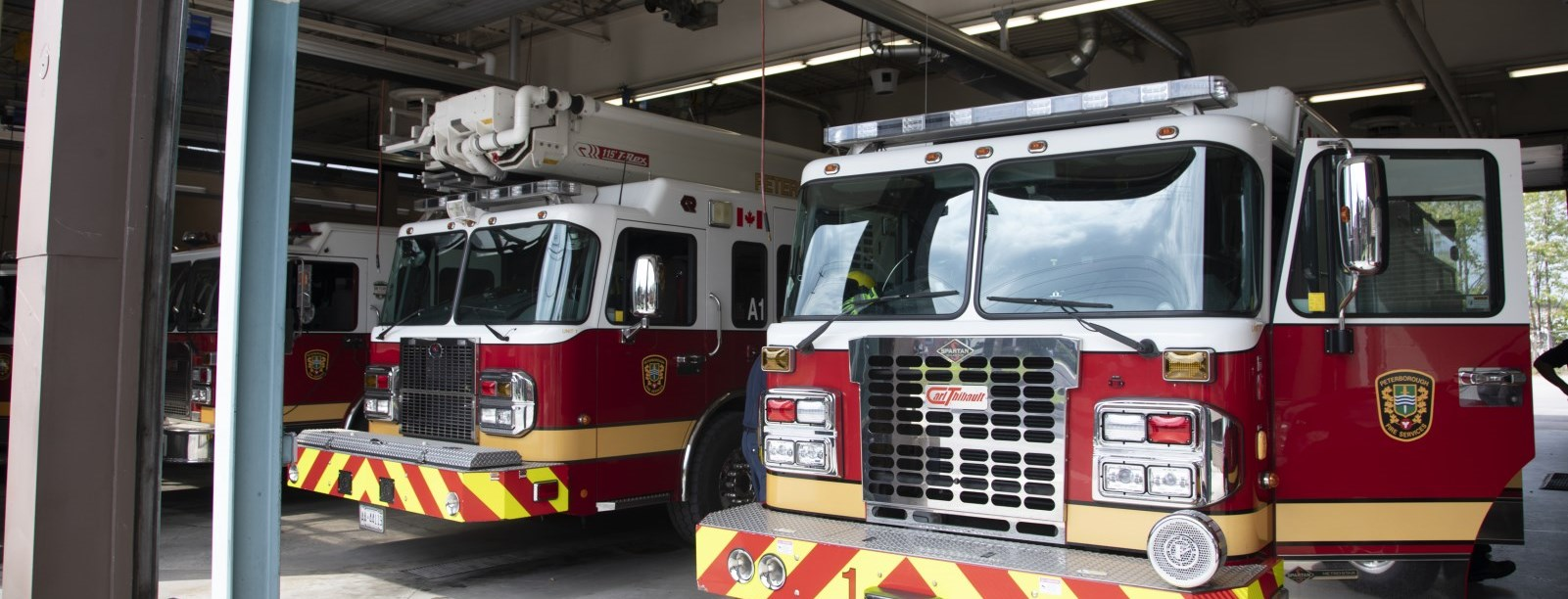 Fire trucks in the fire hall bay