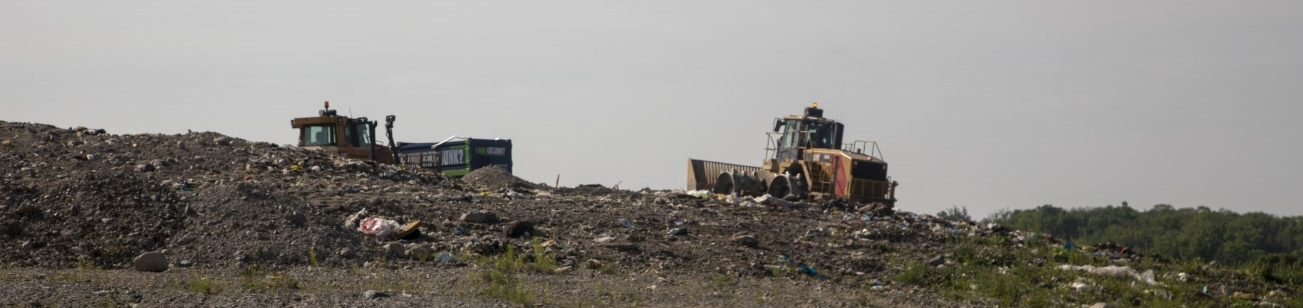 Landfill and tractor