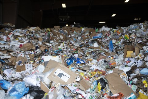 Recyclable materials piled up inside a materials recycling facility