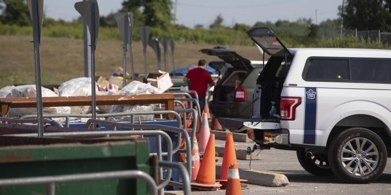 People unloading at the landfill