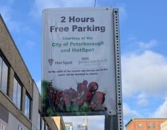 sign downtown advertising free holiday parking