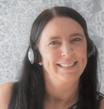 Image of woman using a phone headset.