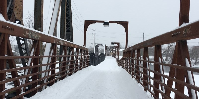 snowy footbridge near Maria Street facing west during daytime
