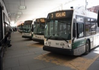 line of buses parked at Simcoe Street transit terminal
