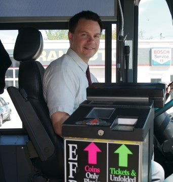 Bus Operator behind the wheel of a transit bus