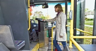 a rider pays fare as they board the bus