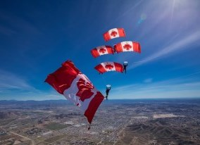 Skyhawks parachuting with Canada Flag