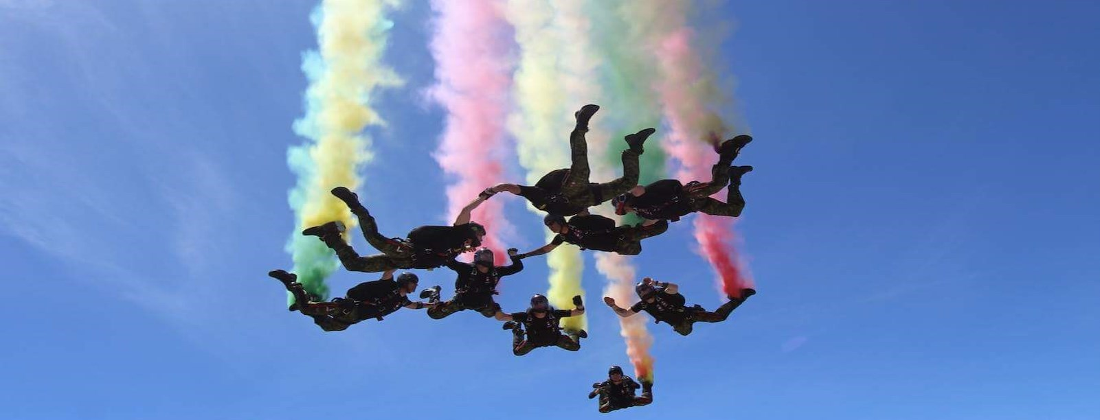 Skyhawks skydiving with colourful streams