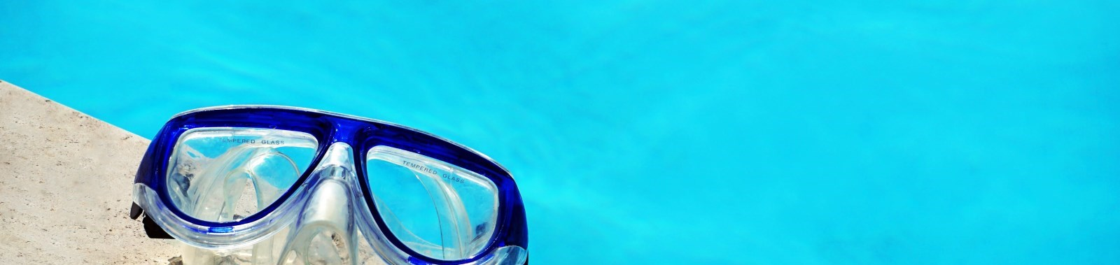 Swim googles next to pool