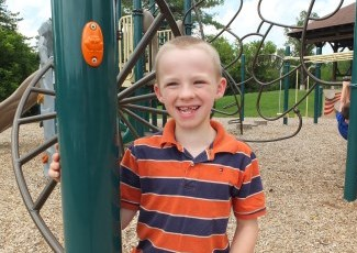 kid smiling on playground