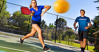 young adults playing pickleball