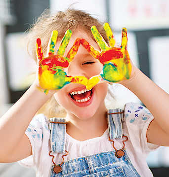 young girl with paint on hands