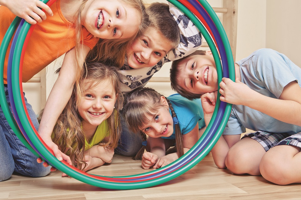 Children playing with hula hoop