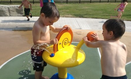 Boys playing at Rogers Cove splashpad