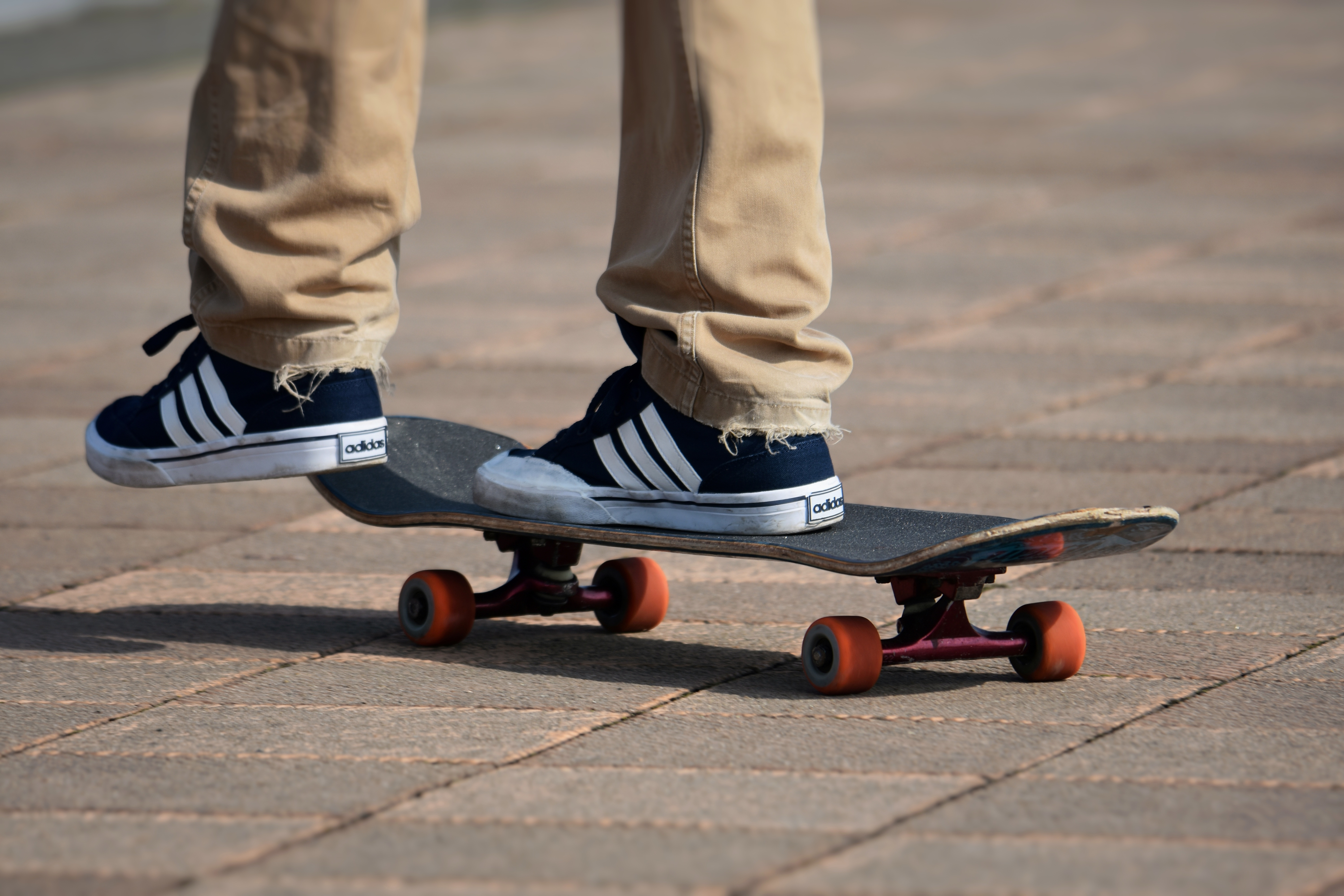 Persons feet on a skateboard in the air