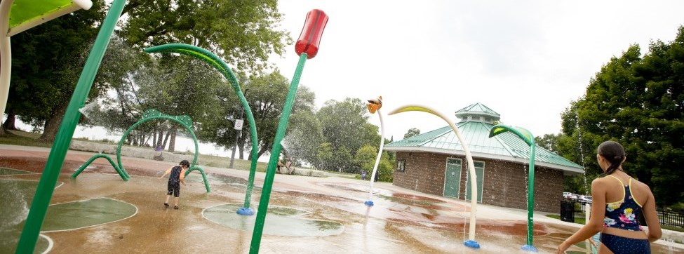Children playing at a splash pad in the spraying water