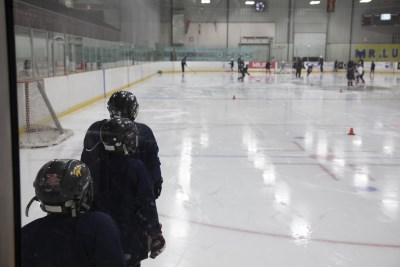 Youth skating on an ice pad at the Evinrude Centre
