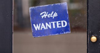 Photo of a help wanted sign.