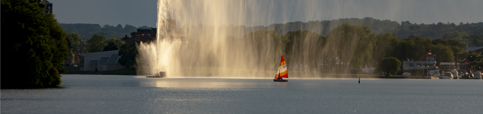 Small sail boat and jet fountain on Little Lake